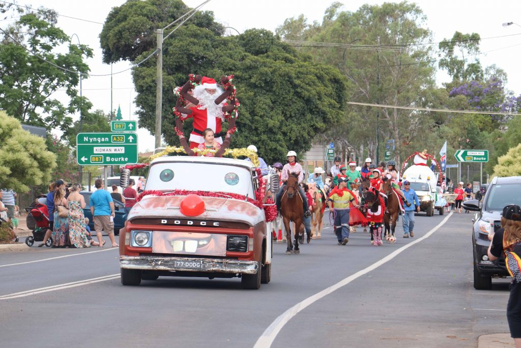 It's the most wonderful time of the year, when the Cobar Business Association's Street Parade signals that it's almost Christmas time! Last Thursday's parade was one of the biggest and best yet with much larger and more elaborate floats including Cobar Shire  Council's giant snowman that blew out fake snow, which won the Margaret's Choice Best Float award. This year Santa arrived on a new mode of transport, 'Mater' the Dodge truck, and was followed by an array of colourful community and sporting groups. Many  businesses opened for late night shopping, and there was also plenty of market stalls and a variety of children's entertainment to keep everyone happy. See Page 17 and Page 30 for more photos from the night or go to www.cobarweekly to view photos in colour.